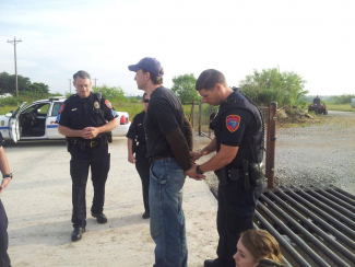Adam Briggle being taken in for peaceful protest. Denton, Texas, on 01 June 2015.
